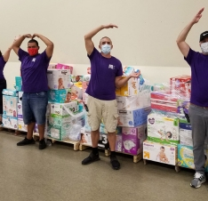 Volunteers standing in front of donation