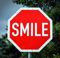 stop sign that reads smile